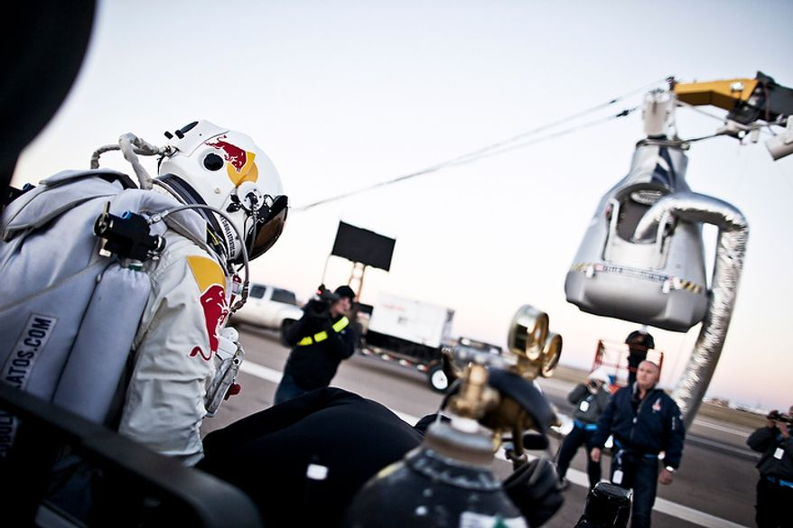 In this photo provided by Red Bull, pilot Felix Baumgartner of Austria steps out from his trailer during the final manned flight for Red Bull Stratos in Roswell, N.M. on Oct. 14, 2012. Baumgartner plans to jump from an altitude of 120,000 feet, an altitude chosen to enable him to achieve Mach 1 in free fall, which would deliver scientific data to the aerospace community about human survival from high altitudes. (Associated Press/Red Bull)