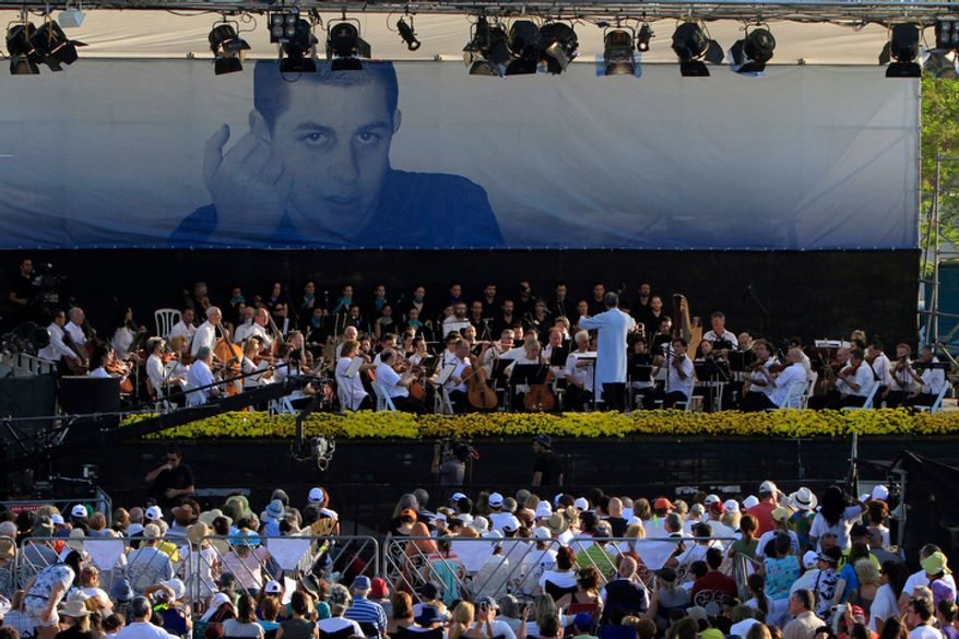 Indian-born conductor Zubin Mehta conducts the Israel Philharmonic Orchestra during a concert for captured Israeli soldier Gilad Schalit (pictured at top) in the Eshkol Park near the Gaza Strip in southern Israel on Monday, July 5, 2010. (AP Photo/Tsafrir Abayov)