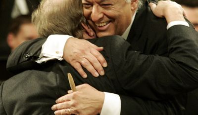 Indian-born conductor Zubin Mehta (right) hugs Werner Hink, first violinist of the Vienna Philharmonic Orchestra, during the traditional New Year's concert at Vienna's Musikverein on Monday, Jan. 1, 2007. (AP Photo/Hans Punz)