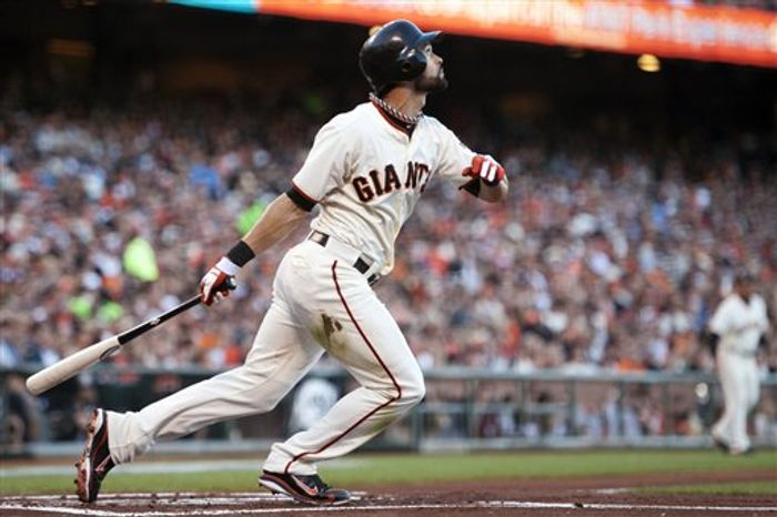 San Francisco Giants' Angel Pagan (16) watches the flight of his first-inning home run against the St. Louis Cardinals during Game 2 of the National League Championship Series, Monday, Oct. 15, 2012, in San Francisco. The Giants won 7-1 to even the series at one game each. (AP Photo/The Sacramento Bee, Paul Kitagaki Jr.)