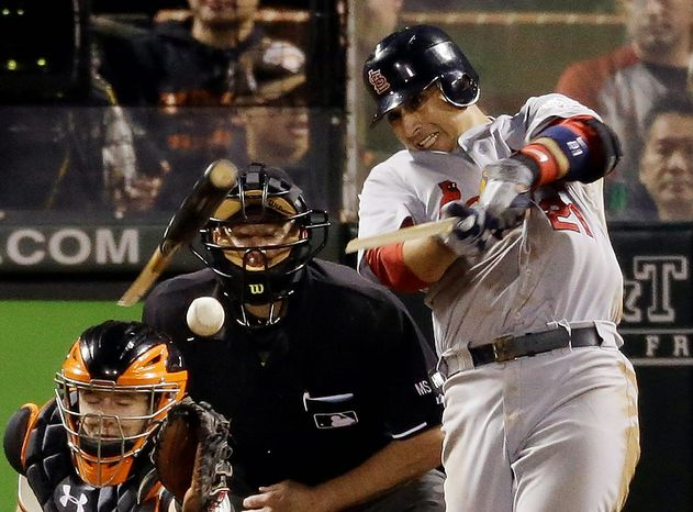 St. Louis Cardinals' Allen Craig breaks his bat as he grounds out during the eighth inning of Game 1 of baseball's National League championship series against the San Francisco Giants Sunday, Oct. 14, 2012, in San Francisco. (AP Photo/Mark Humphrey)