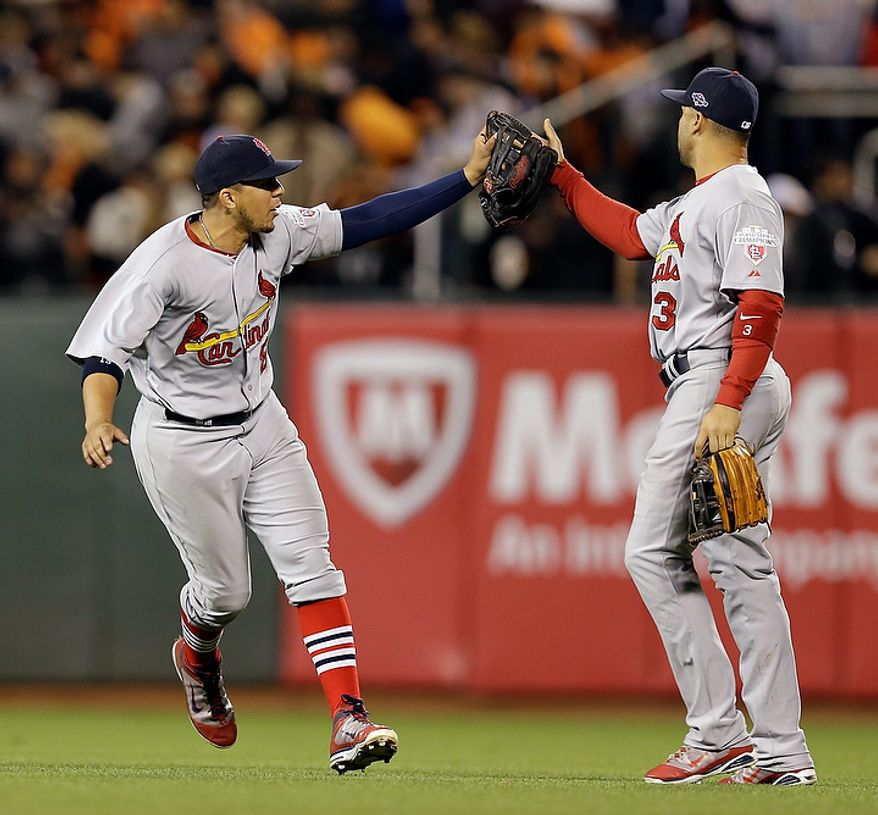 St. Louis Cardinals' Jon Jay (19) and Carlos Beltran (3) celebrate after Game 1 of baseball's National League championship series against the San Francisco Giants Sunday, Oct. 14, 2012, in San Francisco. The Cardinals won 6-4. (AP Photo/David J. Phillip)