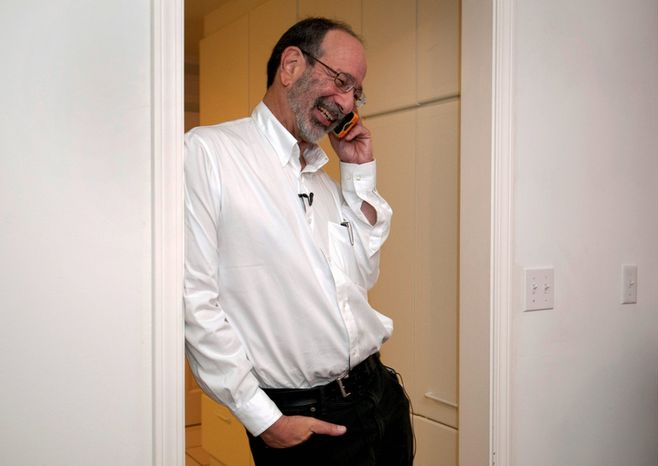 Alvin Roth, a Harvard University scholar who is a visiting professor at Stanford University, takes a phone call at his home in Menlo Park, Calif., on Monday, Oct. 15, 2012, after being awarded the Nobel economics prize. Mr. Roth, 60, and Lloyd Shapley, 89, two Americans, were awarded the Nobel for their studies on the matchmaking that takes place when doctors are coupled up with hospitals, students with schools and human organs with transplant recipients. The work of two has sparked a flourishing field of research and helped improve the performance of many markets, the Royal Swedish Academy of Sciences said. (AP Photo/Stanford News Service, Linda A. Cicero)