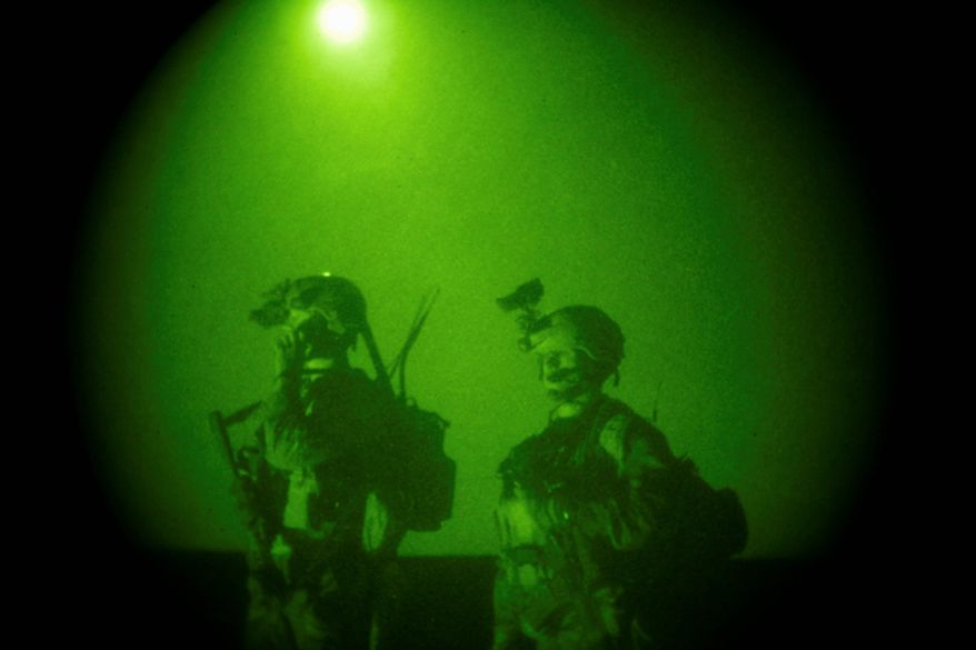 In this Oct. 28, 2008 file photo, taken with a night vision scope, U.S. Special Operations forces are seen during a joint operation with Afghan National Army soldiers targeting insurgents operating in Afghanistan's Farah province.  Small teams of U.S. special operations forces arrived at American embassies throughout North Africa to set up a new counterterrorist network months before militants killed the U.S. ambassador in Libya. But officials say the network was too new to stop the Benghazi attack. (AP Photo/Maya Alleruzzo, File)