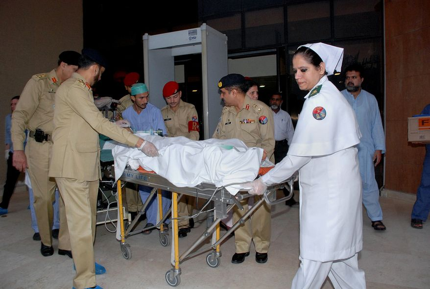 Pakistani army doctors and medical staff transport 14-year-old schoolgirl Malala Yousufzai, who was shot Tuesday by the Taliban, from a military hospital to the airport in Rawalpindi, Pakistan, on Monday, Oct. 15, 2012, for an airlift to England. (AP Photo/Inter Services Public Relations Department)