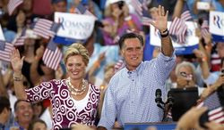 Republican presidential candidate Mitt Romney waves with his wife, Ann, during a Oct. 7, 2012, campaign rally in Port St. Lucie, Fla. (Associated Press)