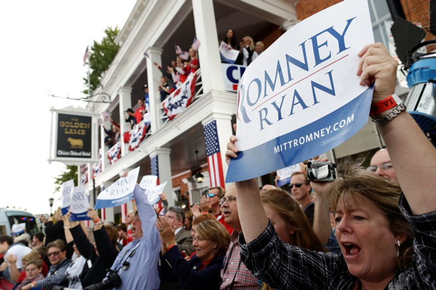 The crowd cheers as Republican presidential candidate Mitt Romney campaigns in front of The Golden Lamb Inn and Restaurant in Lebanon, Ohio, on Oct. 13, 2012. (Associated Press)