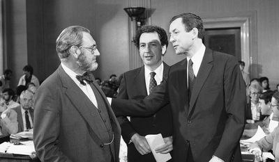 **FILE** Dr. Everett Koop (left), who had been nominated to be the U.S. surgeon general, chats Oct. 1, 1981, with Republican Sens. Arlen Specter (center), of Pennsylvania, and Orrin Hatch, of Utah, prior to appearing before the Senate Labor and Human Resources Committee on Capitol Hill in Washington for Koop's confirmation hearings. (Associated Press)