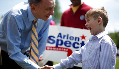 **FILE** Sen. Arlen Specter, Pennsylvania Democrat, shakes hands with Victor Cazzone, 7, of Exton, Pa., during a May 15, 2010, campaign rally at Gateway Park in Coatesville, Pa. (Associated Press)