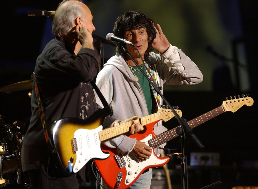 Rolling Stone Band member Ronnie Wood, right, joins the Crickets on stage at the Strat Pack Concert held at London's Wembley Arena, Friday Sept. 24, 2004. The Strat Pack Concert is celebrating 50 years of the iconic guitar in which musicians payed homage to the Fender Stratocaster at a charity concert for Nordoff-Robbins Music Therapy. (AP Photo/Richard Lewis)
