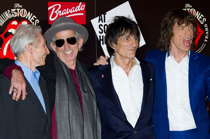 From left, Charlie Watts, Keith Richards, Ronnie Wood and Mick Jagger, from the British Rock band, The Rolling Stones, arrive at a central London venue, to mark the 50th anniversary of the Rolling Stones first performance, Thursday, July 12, 2012. (AP Photo/Jonathan Short)
