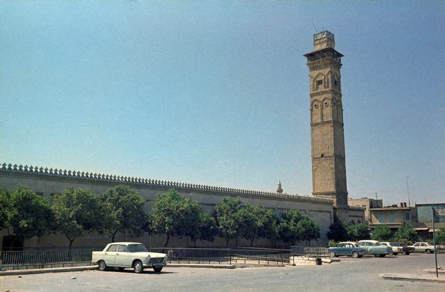 ** FILE ** The Umayyad mosque in Aleppo, Syria, is pictured in 1973. Syrian President Bashar Assad ordered on Monday, Oct. 15, 2012, immediate repairs to the historic mosque in a move likely aimed at containing Muslim outrage after fierce fighting between rebels and regime forces set parts of the mosque on fire over the weekend. (AP Photo/Azad)