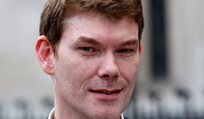 ** FILE ** Gary McKinnon, shown in this file photo from 2009, is charged with breaking into computers belonging to NASA, the Department of Defense and several branches of the U.S. military. (Associated Press)