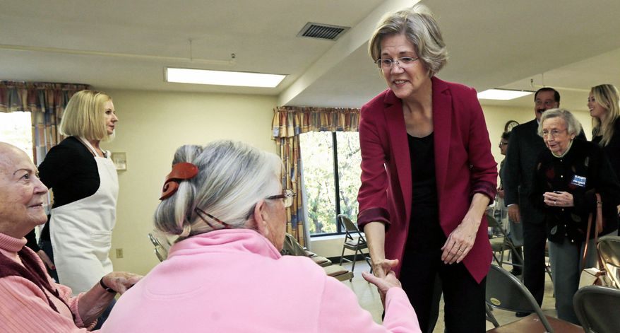 Democratic Senate hopeful Elizabeth Warren campaigns at a senior citizens housing complex in Quincy, Mass., on Tuesday, three weeks before Election Day. (Associated Press)