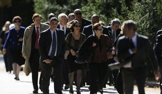Mourners walk Oct. 16, 2012, to Har Zion Temple in Penn Valley, Pa., for former U.S. Sen. Arlen Specter's funeral. Family members say Specter died Sunday of complications from non-Hodgkin lymphoma. He was 82. (Associated Press)