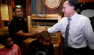 **FILE** Republican presidential candidate Mitt Romney greets customers Oct. 12, 2012, as he makes an unscheduled stop at City Barbeque in Gahanna, Ohio. (Associated Press)