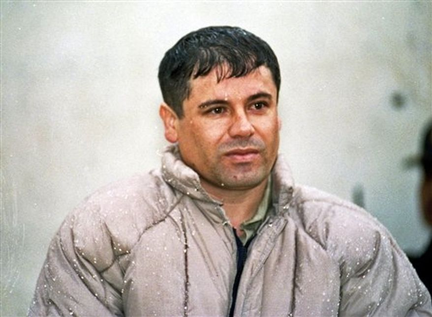 """** FILE ** In this June 10, 1993, file photo, Joaquin """"El Chapo"""" Guzman, leader of Mexico's Sinaloa cartel, appears for reporters after his arrest at the high security prison of Almoloya de Juarez on the outskirts of Mexico City, from which he later escaped. (AP Photo/Damian Dovarganes, File)"""