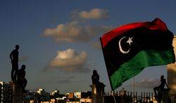**FILE** Libyans watch a Sept. 21, 2012, protest in Benghazi, Libya, against Ansar al-Shariah Brigades and other Islamic militias. (Associated Press)