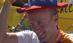 US cyclist Levi Leipheimer jokes prior to the start of the Tour de France cycling race in France, July 15, 2004. Eleven teammates of Lance Armstrong on the U.S. Postal Service Cycling Team including Leipheimer have turned on him offering evidence and testimony to back up allegations that Armstrong used performance-enhancing drugs in competition, the USADA said. The U.S. Anti-Doping Agency released a damning report last week containing testimony from former teammates and other witnesses against Armstrong, and has ordered that he be stripped of his seven Tour de France titles. The international cycling federation is yet to indicate its next move. (AP Photo/Peter Dejong)