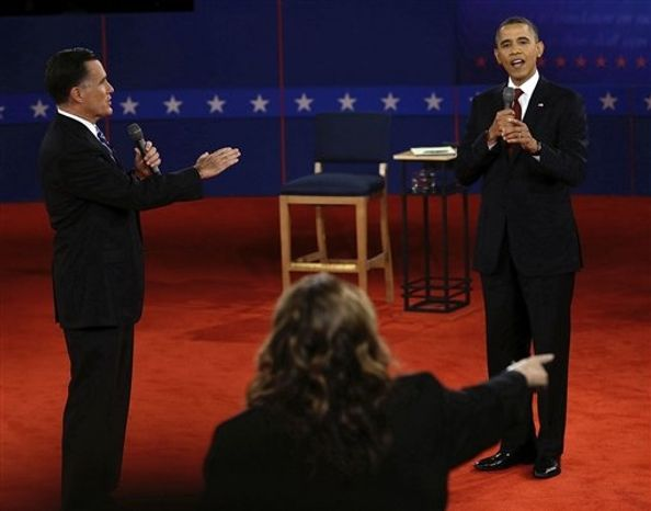 Republican presidential nominee Mitt Romney and and President Barack Obama answer a question during the second presidential debate at Hofstra University, Tuesday, Oct. 16, 2012, in Hempstead, N.Y. (AP Photo/Ch