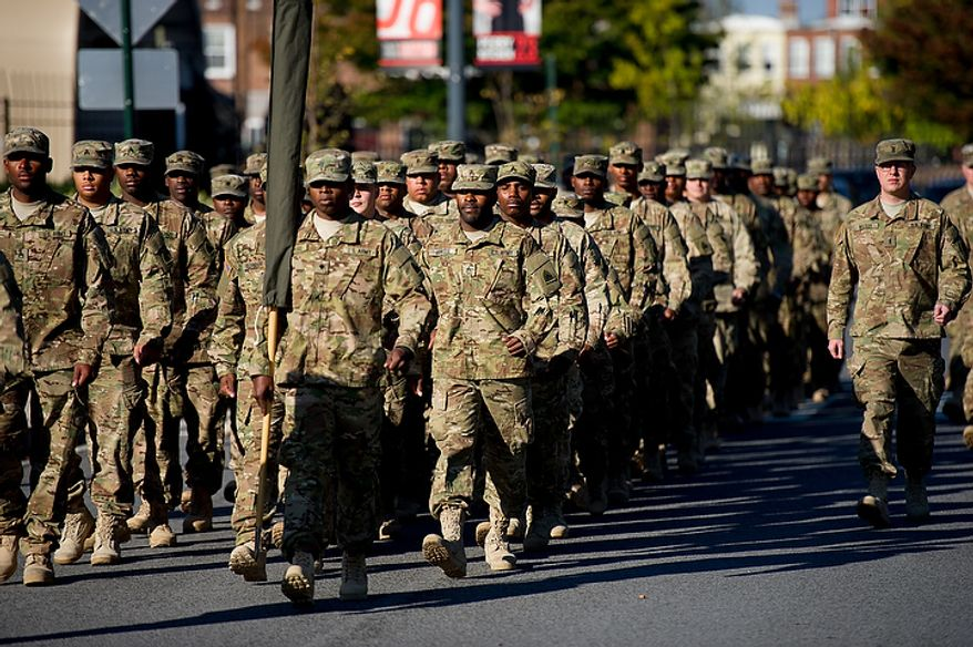 70 D.C. Army National Guard soldiers with the 273rd military police company returning from Bagram Air Base, Afghanistan after 10 months arrive in formation for their welcome home ceremony held in front of the D.C. Armory, Washington, D.C., Tuesday, October 16, 2012. (Andrew Harnik/The Washington Times)