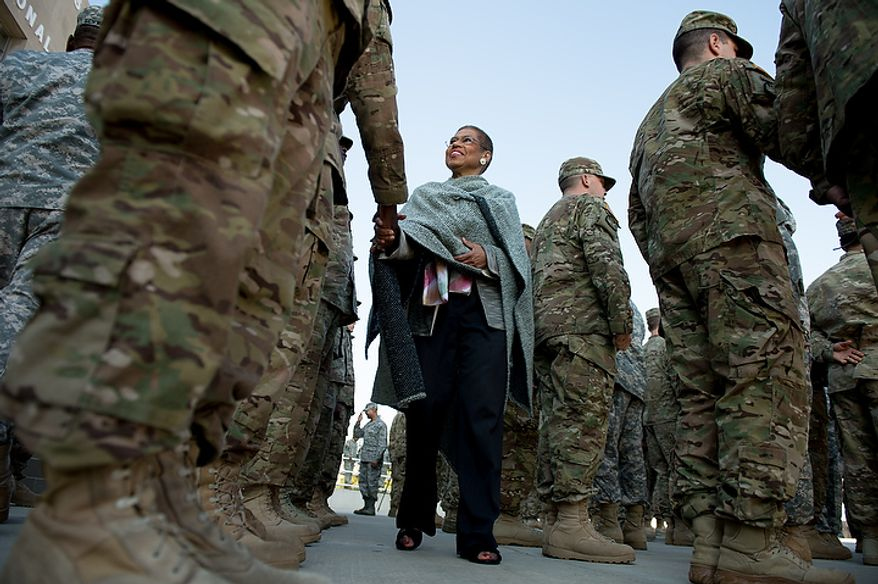 D.C. Congresswoman Eleanor Holmes-Norton greets each of the 70 D.C. Army National Guard soldiers with the 273rd military police company returning from Bagram Air Base, Afghanistan after 10 months during a welcome home ceremony held in front of the D.C. Armory, Washington, D.C., Tuesday, October 16, 2012. (Andrew Harnik/The Washington Times)