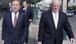 NHL commissioner Gary Bettman, left, arrives with deputy commissioner Bill Daly, right, as the NHL and its locked-out player resume negotiations in Toronto on Wednesday Oct. 16, 2012. (AP Photo/The Canadian Press, Chris Young)