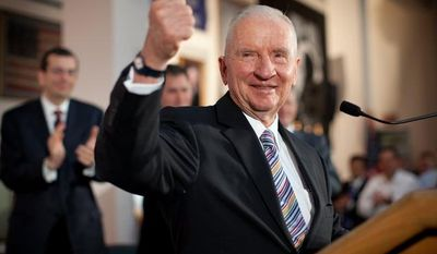 **FILE** H. Ross Perot, chairman emeritus of Perot Systems, gives a thumbs up Sept. 21, 2009, in Dallas during the annoucement that Dell had acquired Perot Systems for $3.9 billion. (Associated Press/Perot Systems)