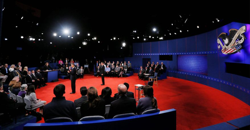 President Barack Obama, left, and Republican presidential nominee Mitt Romney speak to members of the audience during the second presidential debate. (AP Photo/Pool-Shannon Stapleton)