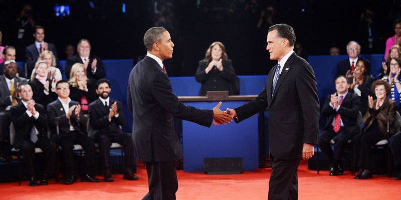 Moderator Candy Crowley, center, applauds as President Barack Obama, right, shakes hands with Republican presidential nominee Mitt Romney during the second presidential debate. (AP Photo/Pool-Michael Reynolds)