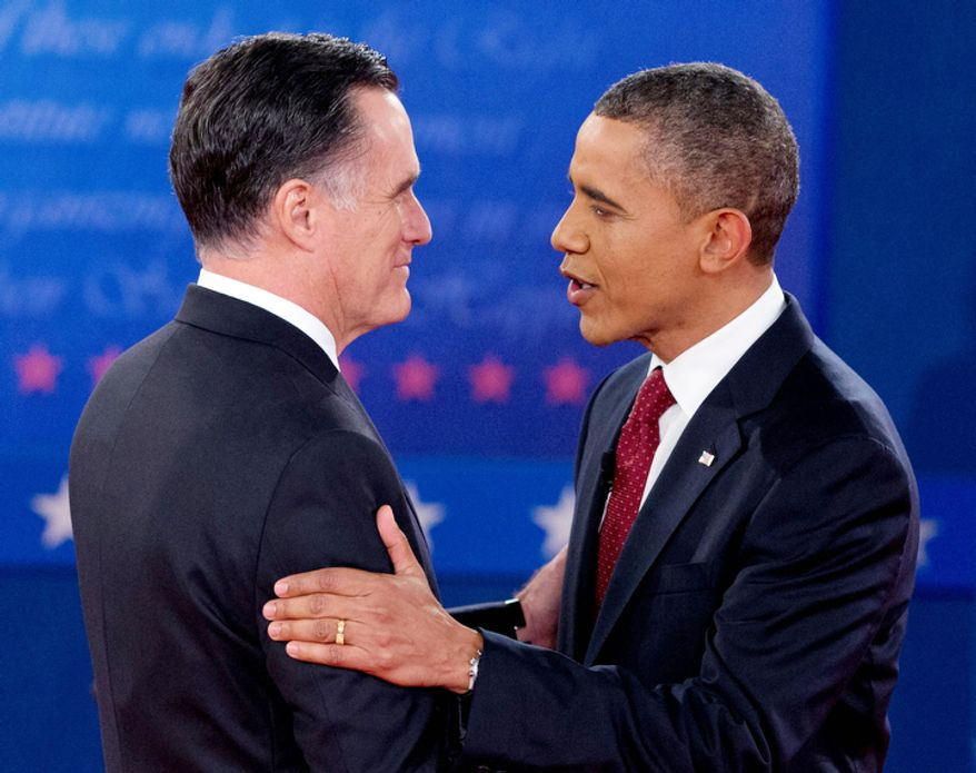 President Barack Obama and Republican presidential candidate, former Massachusetts Gov. Mitt Romney, greet each other as they arrive for the second presidential debate. (AP Photo/Carolyn Kaster)