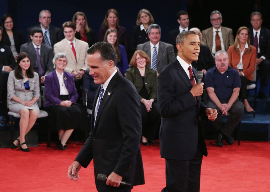 Republican presidential nominee Mitt Romney, left, heads back to his seat after speaking during the second presidential debate with President Barack Obama. (AP Photo/Pool-Win McNamee)