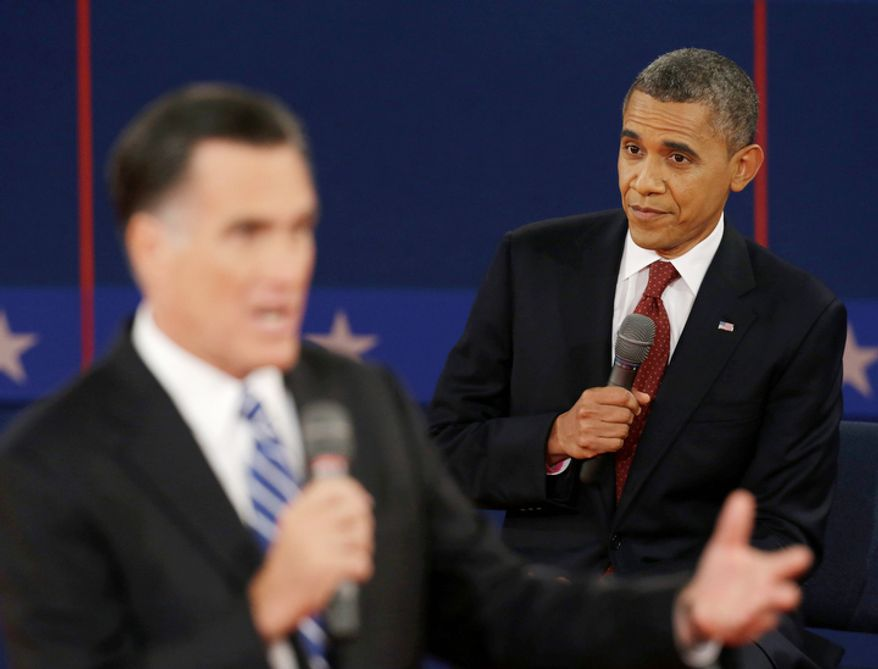 President Barack Obama listens as Republican presidential nominee Mitt Romney speaks during the second presidential debate. (AP Photo/Eric Gay)