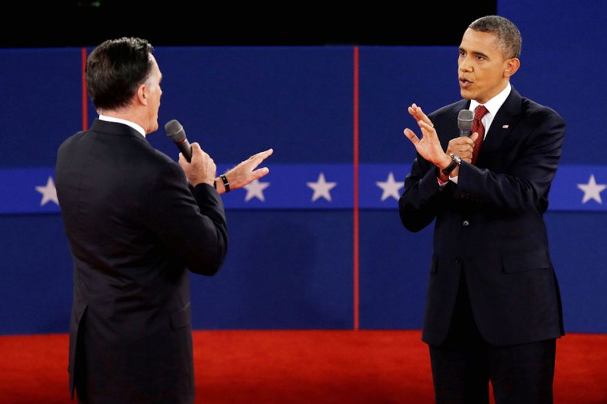 Republican presidential nominee Mitt Romney  and President Barack Obama spar over energy policy during the second presidential debate. (AP Photo/Charlie Neibergall)