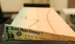 Trays of printed Social Security checks in Philadelphia wait to be mailed from the U.S. Treasury in 2005. (Associated Press) **FILE**