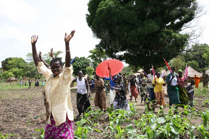 **FILE** Sudanese women welcome Riek Machar, the chief mediator and southern Sudan's vice president, as he arrives April 10, 2008, at Ri-Kwangba in southern Sudan. (Associated Press)