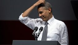 President Barack Obama scratches his head as he speaks during a campaign event at the Bill Graham Civic Auditorium, Monday, Oct. 8, 2012, in San Francisco. (AP Photo/Carolyn Kaster)