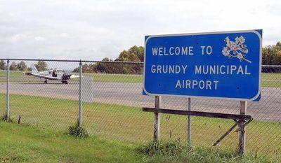 The runway at Grundy Municipal Airport is too short to comply with insurance standards for corporate jets, but federal regulators have refused to allow for an expansion without a mining permit because of the coal deposits below the land. (Debra McCown/Special to The Washington Times)