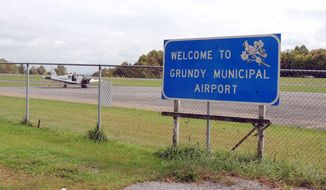 The runway at Grundy Municipal Airport in Virginia coal country is 2,200 feet long. Efforts to lengthen it to 5,700 feet to accommodate larger aircraft have been stymied by federal red tape. (Debra McCown/Special to The Washington Times)