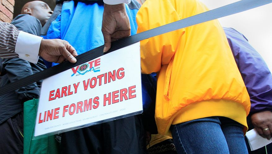 A sign lets people know where to line up for early voting at the Hamilton County Board of Elections in Cincinnati. Tough new election laws aimed at forcing voters in many states to show photo identification at polling places have been blocked or delayed, pleasing opponents who contend the laws were among a variety of partisan attempts to prevent minority voters from casting ballots this election season. (Associated Press)