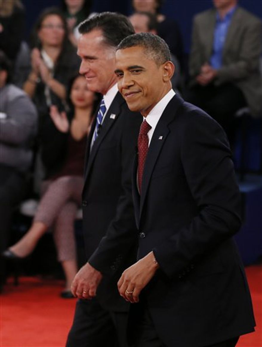 Republican presidential nominee Mitt Romney, left, and President Barack Obama walk together at the end of the second presidential debate at Hofstra University, Tuesday, Oct. 16, 2012, in Hempstead, N.Y. (AP Photo/Pool-Shannon Stapleton)