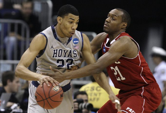 North Carolina State's C.J. Williams, right, pressures Georgetown's Otto Porter (22) during the first half of an NCAA men's college basketball tournament third-round game in Columbus, Ohio, Sunday, March 18, 2012. North Carolina State won 66-63. (AP Photo/Tony Dejak)