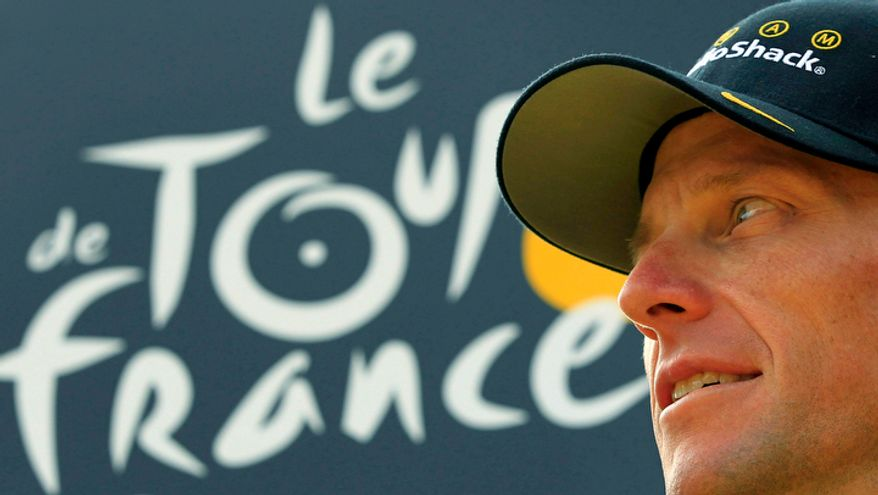 Seven-time Tour de France champion Lance Armstrong looks back on the podium after the 20th and last stage of the Tour de France cycling race in Paris on July 25, 2010. (AP Photo/Bas Czerwinski)