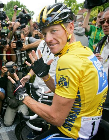 In this July 24, 2005 file photo, Lance Armstrong wears a Nike logo on his jersey prior to the start of the 21st and final stage of the Tour de france cycling race, between Corbeil-Essonnes, south of Paris, and the French capital. Armstrong stepped down as chairman of his Livestrong cancer-fighting charity and Nike severed ties with him as fallout from the doping scandal swirling around the famed cyclist escalated Wednesday, Oct. 17, 2012.  (AP Photo/Peter Dejong, File)