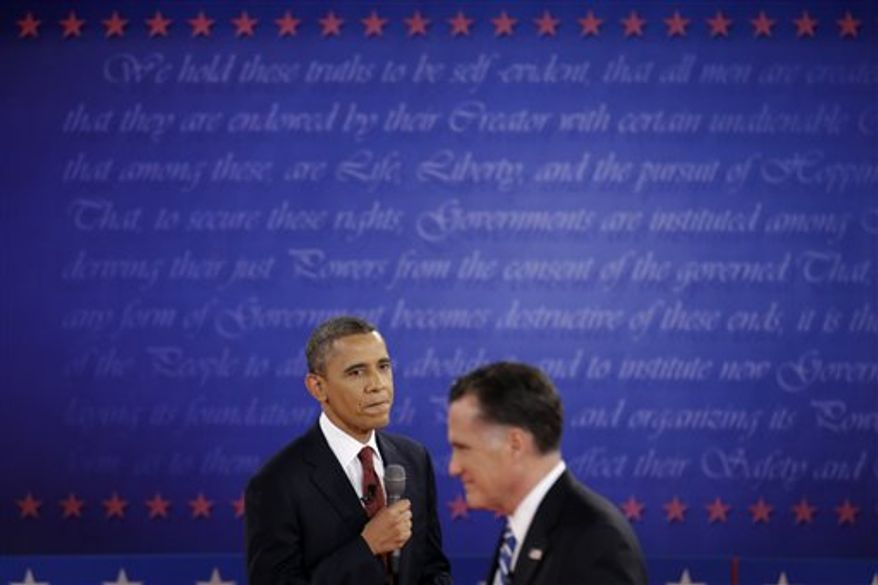 Republican presidential nominee Mitt Romney passes President Barack Obama during the second presidential debate at Hofstra University, Tuesday, Oct. 16, 2012, in Hempstead, N.Y. (AP Photo/David Goldman)
