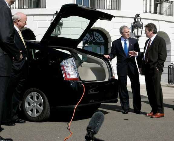 In this Feb. 23, 2007, file photo, President Bush, center, listens to Dave Vieau, President and CEO of A123 Systems, right, as he is shown a Toyota Prius plug-in hybrid car utilizing a lithium power battery during a demonstration of alternative fuel automobiles on the South Lawn of the White House.  Short of cash and hurting from slow sales of electric cars, battery maker A123 Systems Inc. sent its U.S. operations into bankruptcy protection on Tuesday, Oct. 16, 2012, and quickly sold its automotive assets. The filing is likely to stoke the debate in Washington over the Obama administrationís funding of alternative energy companies. In 2009, A123 got a $249 million Department of Energy grant to help it build U.S. factories. Republicans have accused Obama of wasting stimulus money on the companies after the failure of politically connected and now-bankrupt solar power company Solyndra LLC, which left taxpayers on the hook for $528 million. (AP Photo/Charles Dharapak, File)