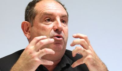 Thierry Coste of the European Union farmers union addresses the media in Brussels on Wednesday, Oct. 17, 2012, about the worst wine-grape harvest for the region in a half-century. (AP Photo/Yves Logghe)