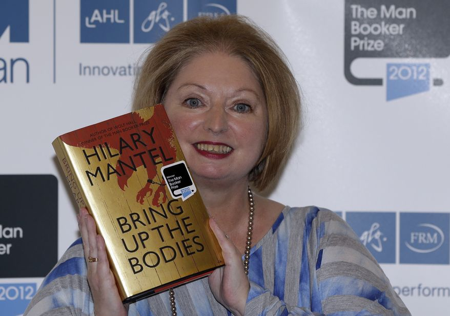 """Hilary Mantel, winner of the Man Booker Prize for Fiction, poses with a copy of her book """"Bring Up the Bodies,"""" shortly after the award ceremony in central London on Tuesday, Oct. 16, 2012. Miss Mantel received 50,000 British pounds ($80,000) for her second Booker win. (AP Photo/Lefteris Pitarakis)"""