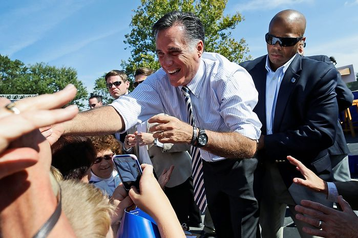 Republican presidential candidate Mitt Romney greets supporters Oct. 17, 2012, during a campaign stop at Tidewater Community College in Chesapeake, Va. (Associated Press)