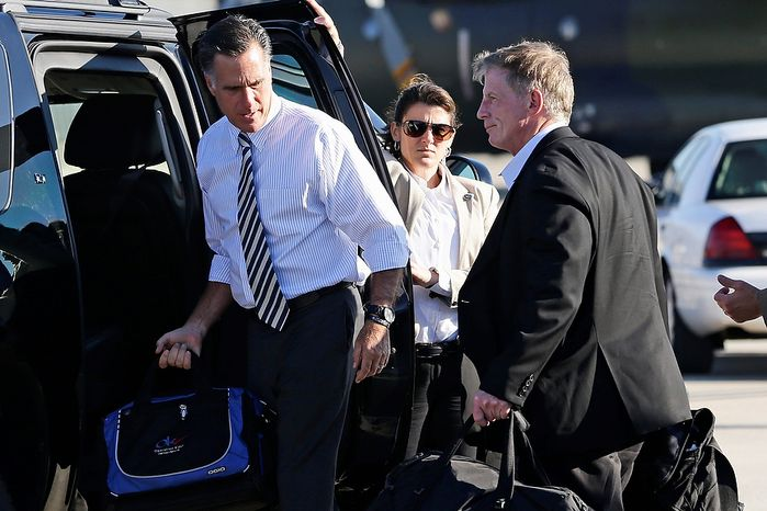 Republican presidential candidate Mitt Romney and his campaign strategist Stuart Stevens (right) arrive Oct. 17, 2012, at Washington Dulles International Airport in Chantilly, Va. (Associated Press)